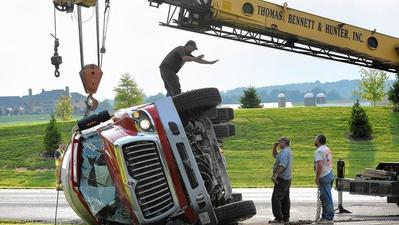 Overturned cement mixer temporarily shuts down Md. 97