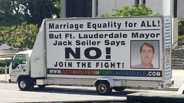 A moving Marriage Equality billboard criticizes Fort Lauderdale Mayor Jack Seiler for opposing a June city resolution supporting gay marriage. The sign's listed web site redirects visitors to the A Better Fort Lauderdale blog run by Earl Rynerson, who opposed Seiler in the last two elections.