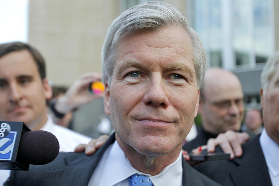 Former Governor Bob McDonnell answers questions from reporters as he leaves the courthouse after testifying his own defense during his trial Wednesday in Richmond.