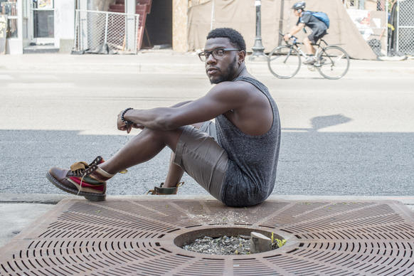Brandon Holmes, 25, sitting next to the spot where his bike was stolen.