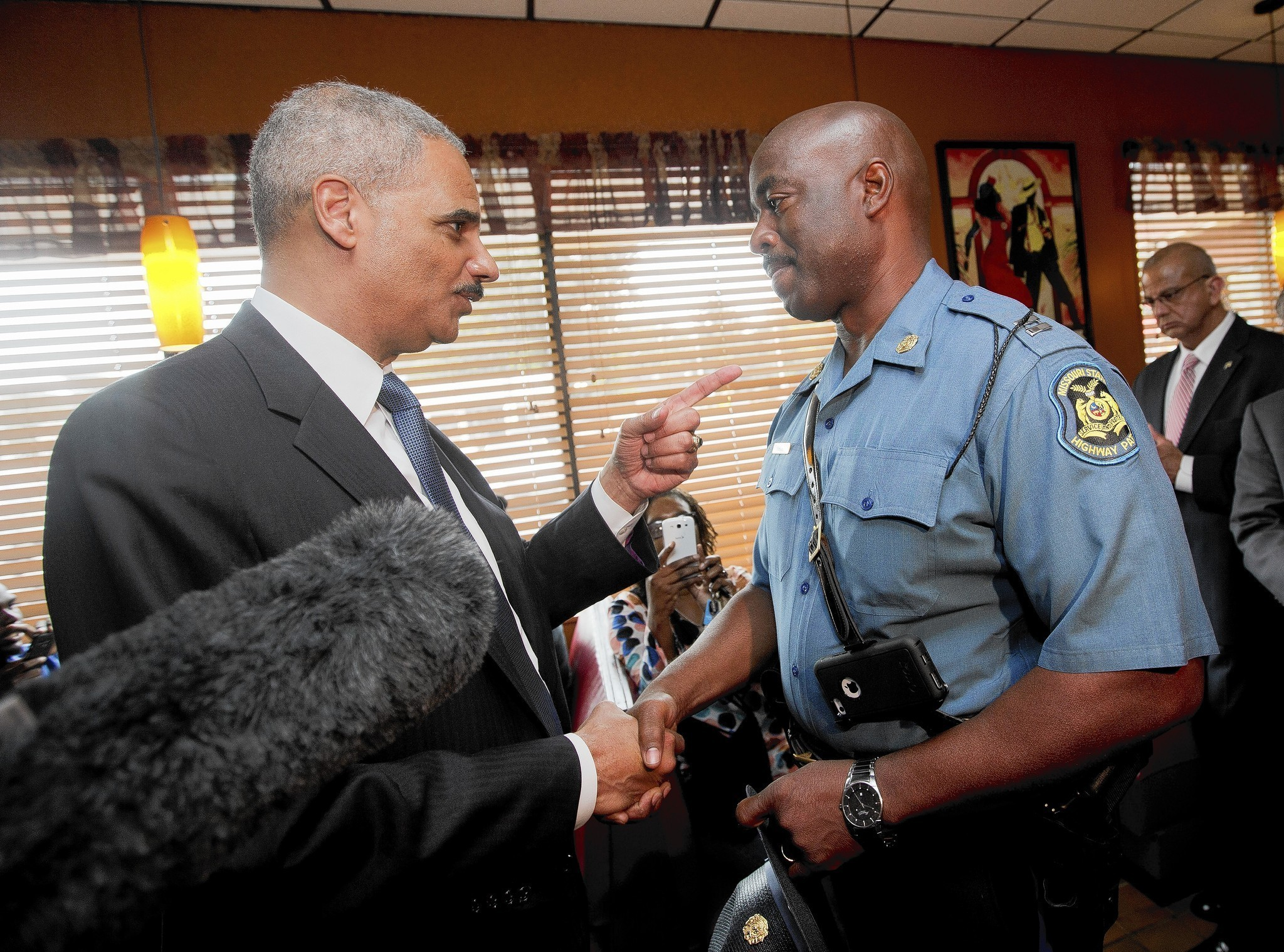 In Ferguson, Holder recalls own 'humiliating' experiences with police