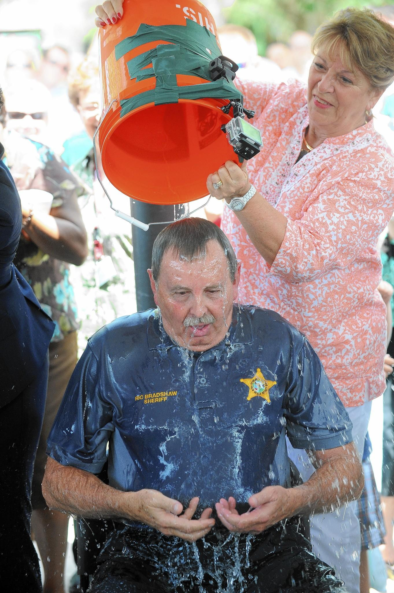 Palm Beach County Sheriff Ric Bradshaw, along with State Attorney Dave Aronberg and Public Defender Carey Haughwout, took the ALS Ice Bucket Challenge at the Palm Beach County Sheriff's Department as a large group of friends, employees and supporters cheered along on Tuesday, August 19th, 2014.