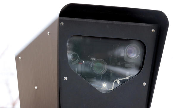 Detail of a Redflex camera at the intersection of Diversey, Damen, and Clybourn in Chicago.