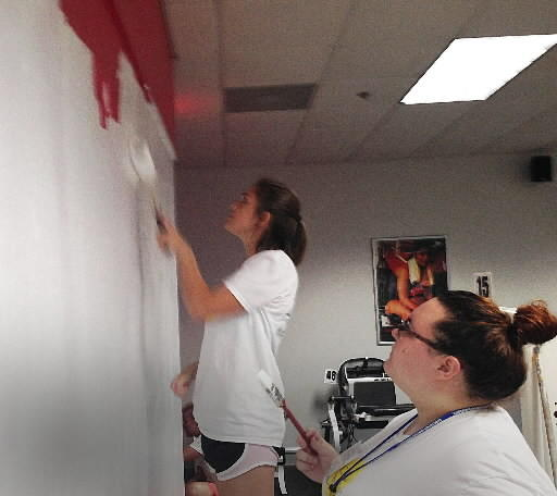 "Nicole Jacoby, left, and Kelsey Schnoebelen help paint a wall at the YMCA in Newport News Thursday as part of the CNU ""Day One of Service"" project."