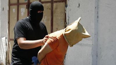 Gunmen execute 18 alleged collaborators in Gaza; Israel launches air strikes