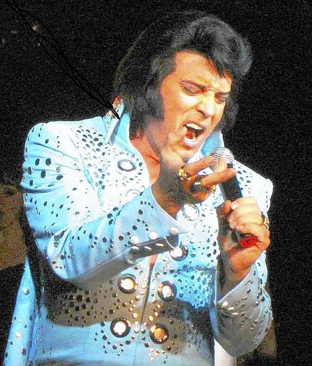 Bill Cherry performs as Elvis.
