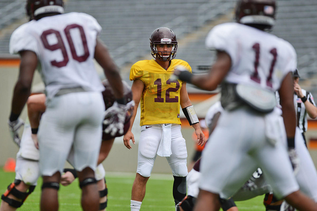 Virginia Tech quarterback Michael Brewer is competing to earn the Hokies' starting quarterback job.