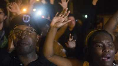 Restrained protests in Ferguson; Local cop suspended for boasting about killing