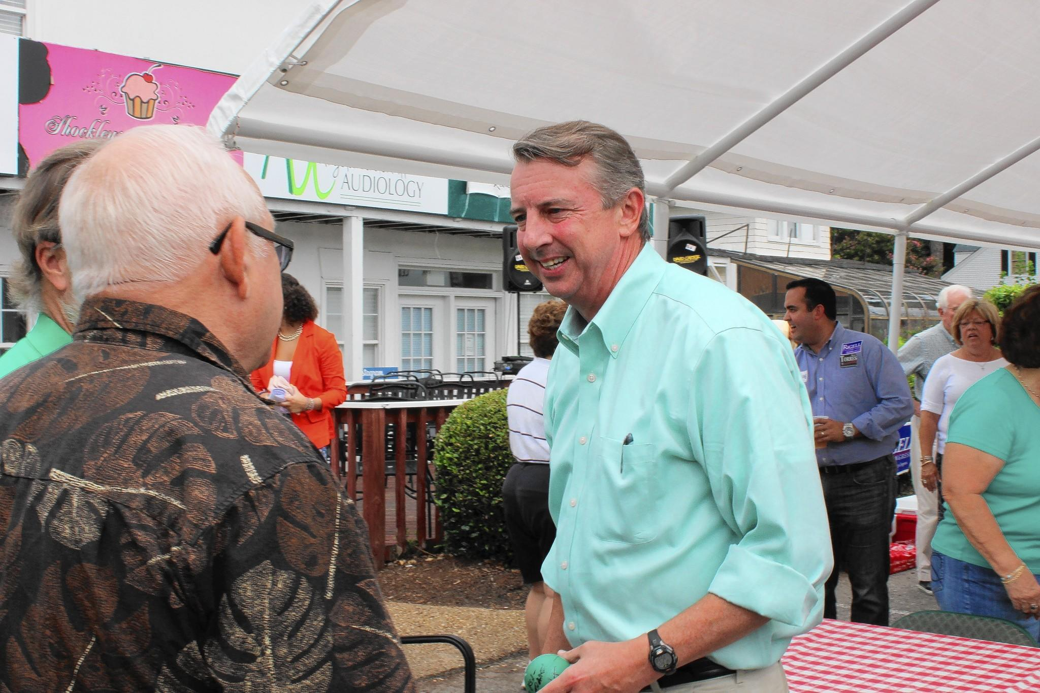 Ed Gillespie, a Republican challenger for Sen. Mark Warner's Senate seat, talks with supporters at a campaign event in Virginia Beach Saturday afternoon.