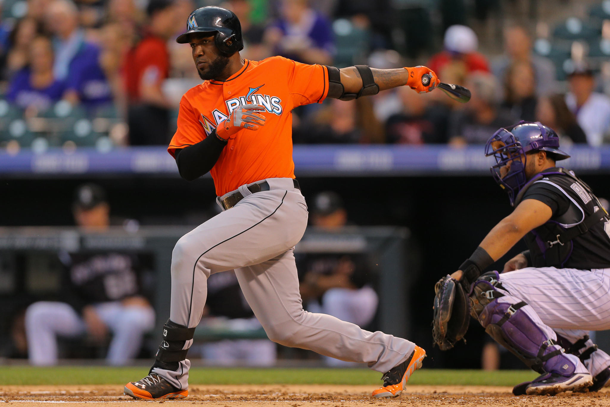 Marcell Ozuna #13 of the Miami Marlins watches his double during the second inning against the Colorado Rockies at Coors Field on August 22, 2014 in Denver, Colorado. Ozuna would go on to score in the inning.