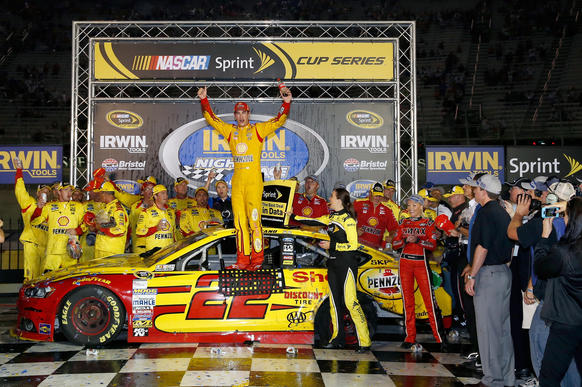 Joey Logano, driver of the #22 Shell Pennzoil Ford, celebrates in Victory Lane after winning the NASCAR Sprint Cup Series Irwin Tools Night Race at Bristol Motor Speedway on August 23, 2014 in Bristol, Tennessee.