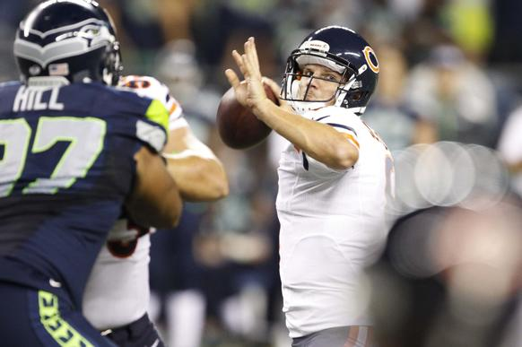 Jimmy Clausen passes against the Seahawks during the fourth quarter at CenturyLink Field.