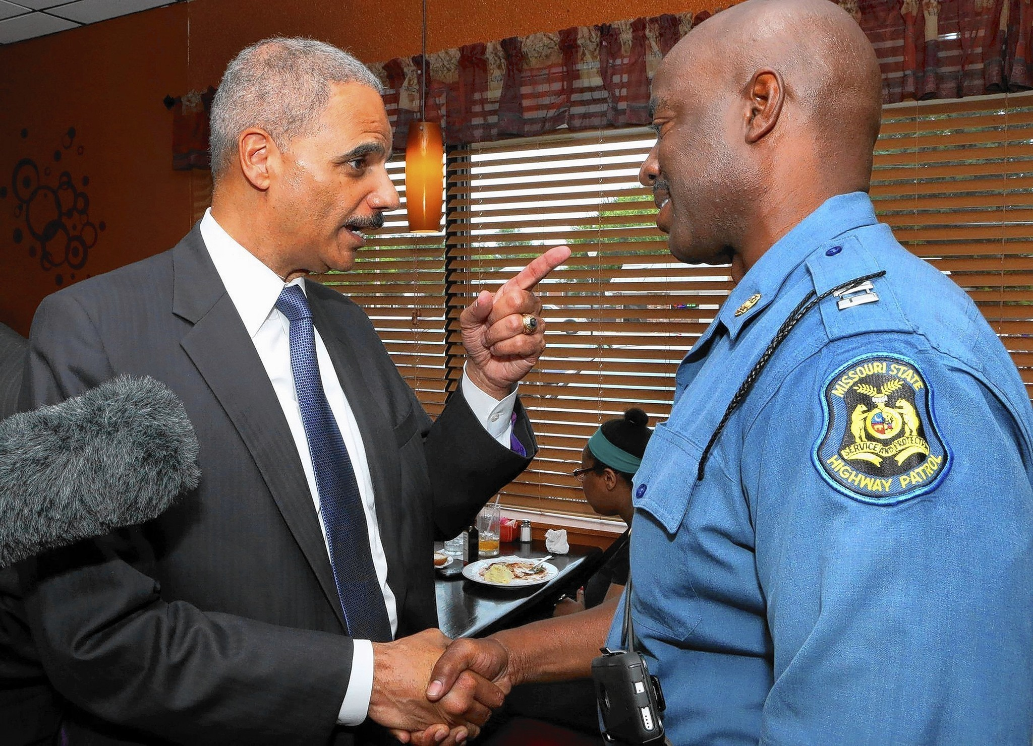 http://www.trbimg.com/img-53faae95/turbine/ct-eric-holder-ferguson-michael-brown-riots-perspe-20140823