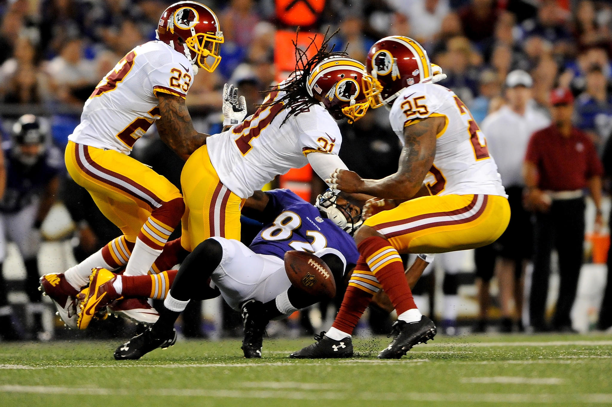 Redskins safety Brandon Meriweather hits Torrey Smith during last Saturday's preseason game.