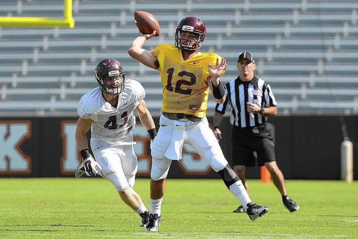Virginia Tech quarterback Michael Brewer throws the ball during a scrimmage Saturday at Lane Stadium in Blacksburg.