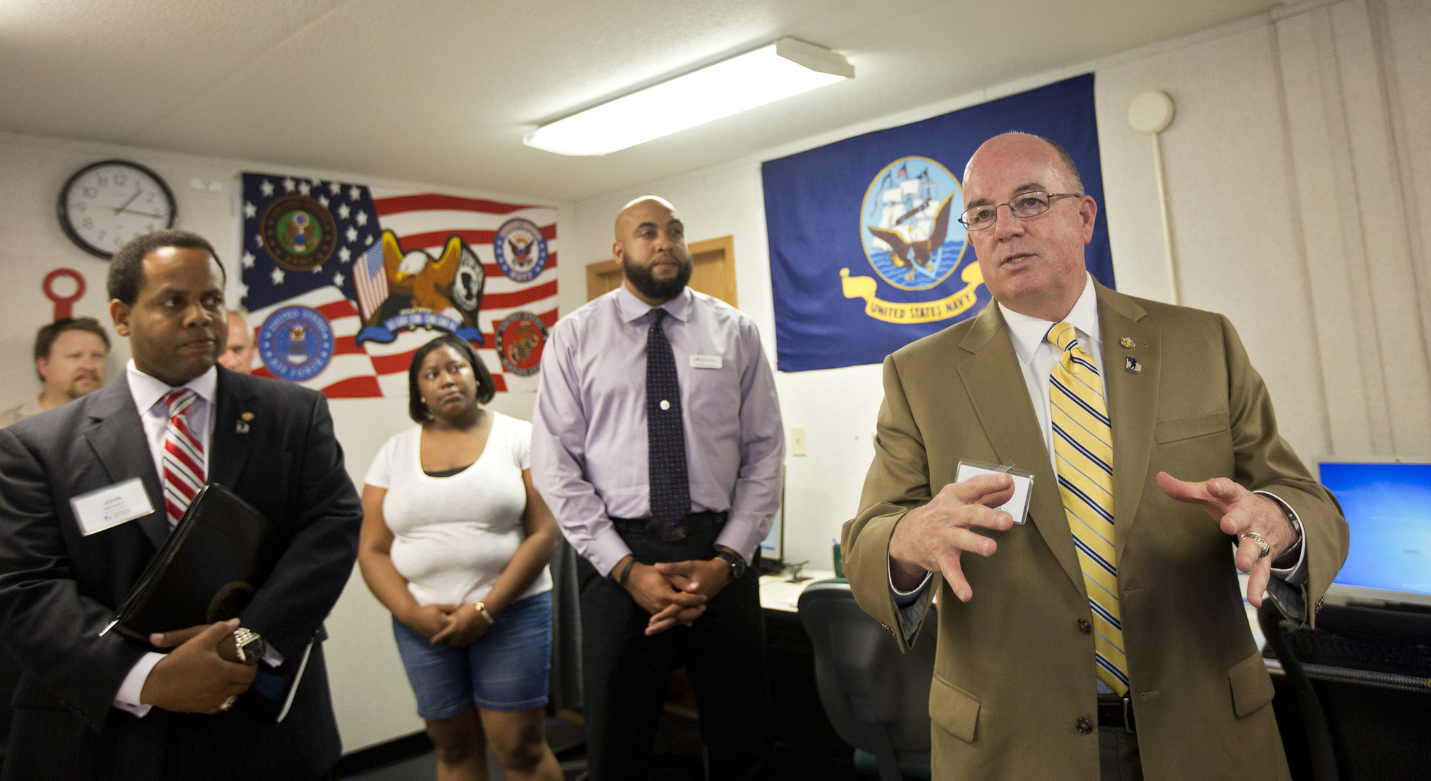 John C. Harvey, Jr., Virginia Secretary of Veterans and Defense Affairs, right, speaks with students, faculty and community representatives at the new Veteran Services Center at Thomas Nelson Community College on Tuesday.