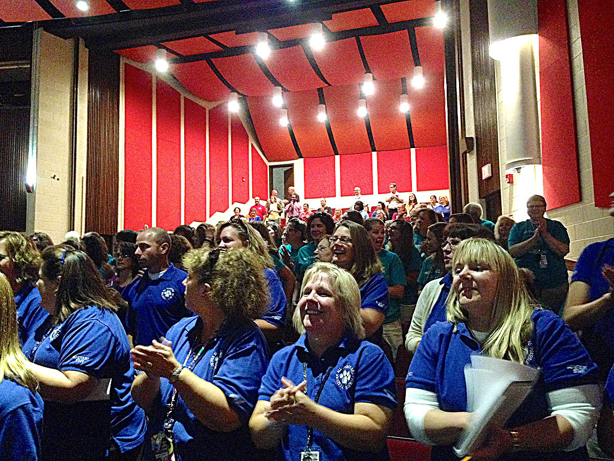 "Gloucester teachers were brought to their feet in excitement at Monday's convocation when Superintendent Walter Clemons played Pharrell Williams' hit song ""Happy"" prior to welcoming the teachers and staff back to a new school year."