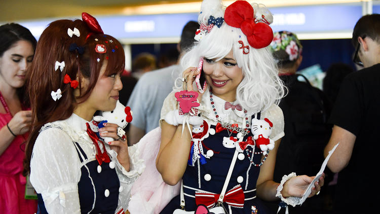 Two young women in Hello Kitty gear at Comic-Con