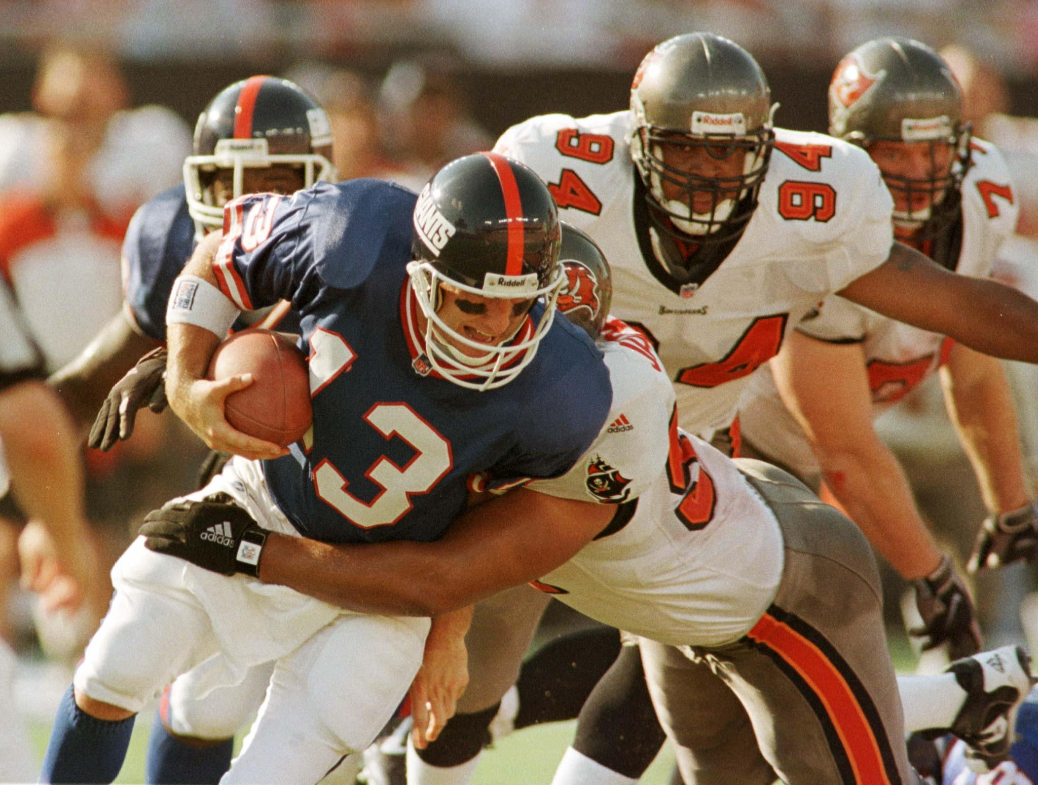 New York Giants quarterback Danny Kanell is sacked for a 12-yard loss in the second quarter by Tampa Bay Buccaneers defender Tyoka Jackson October 4. The NFL contest was played in Tampa's new Raymond James Stadium. Above right is Bucs defender Steve White.