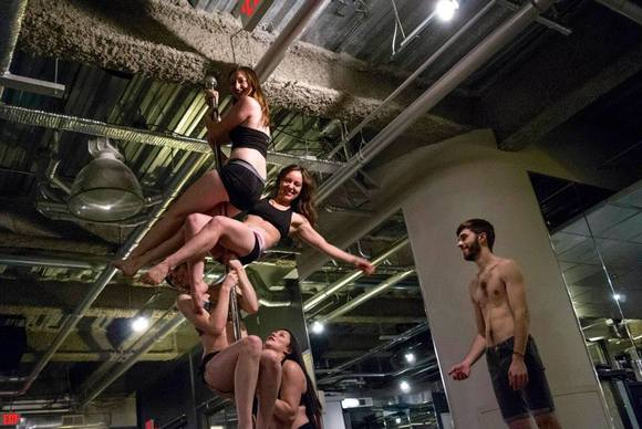 Anthony Abbonato, 21, teaches an Illini Pole Fitness class at the University of Illinois at Urbana-Champaign.