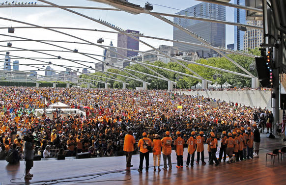 Jackie Robinson West players stand on stage before being introduced at a rally at Pritzker Pavilion in Millennium Park.
