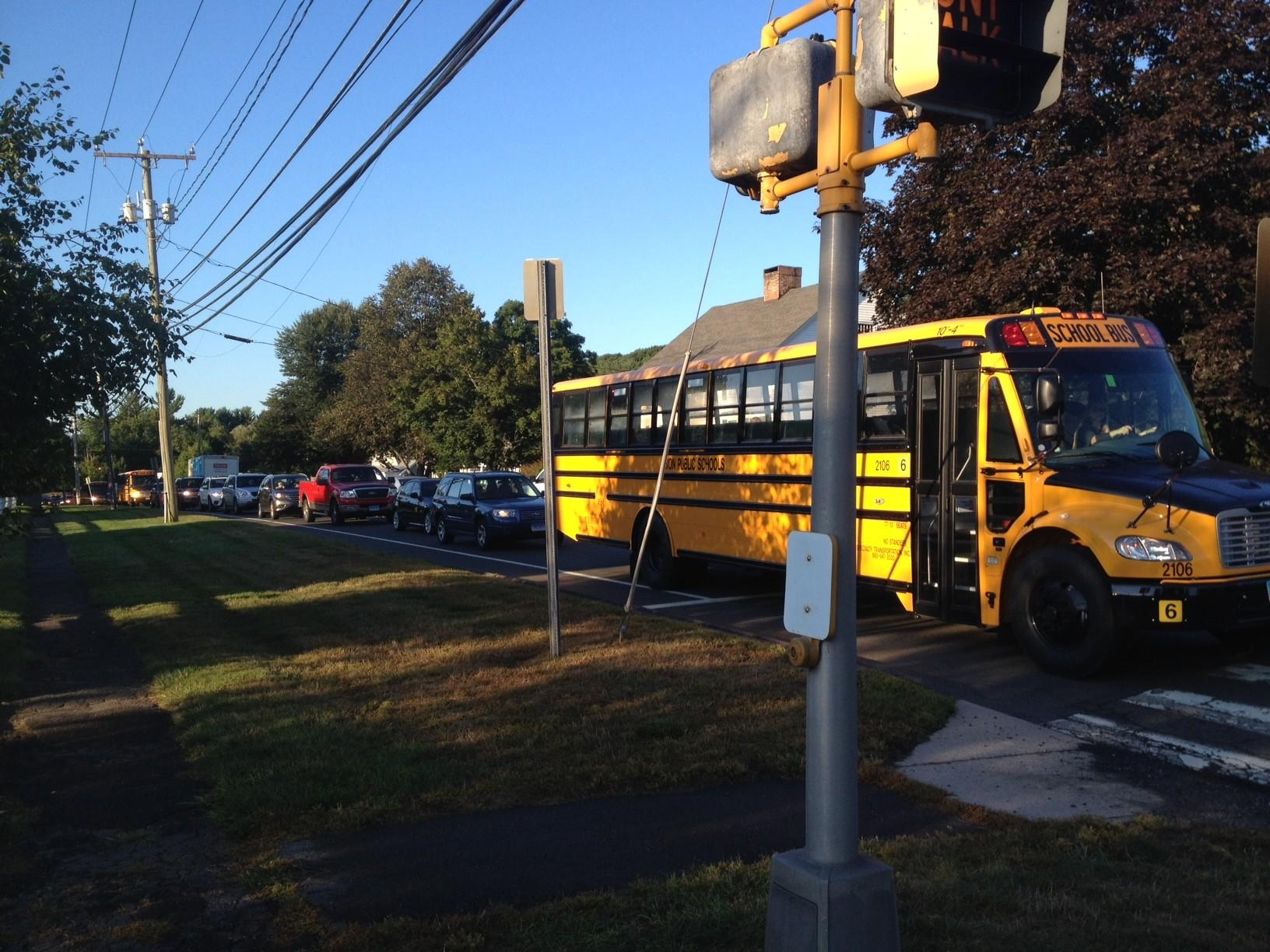 School buses and cars are backed up near Avon Middle School on the first day of classes on Thursday.