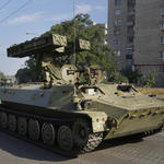 Russia sends tanks and troops into Ukraine, seizes a strategic town