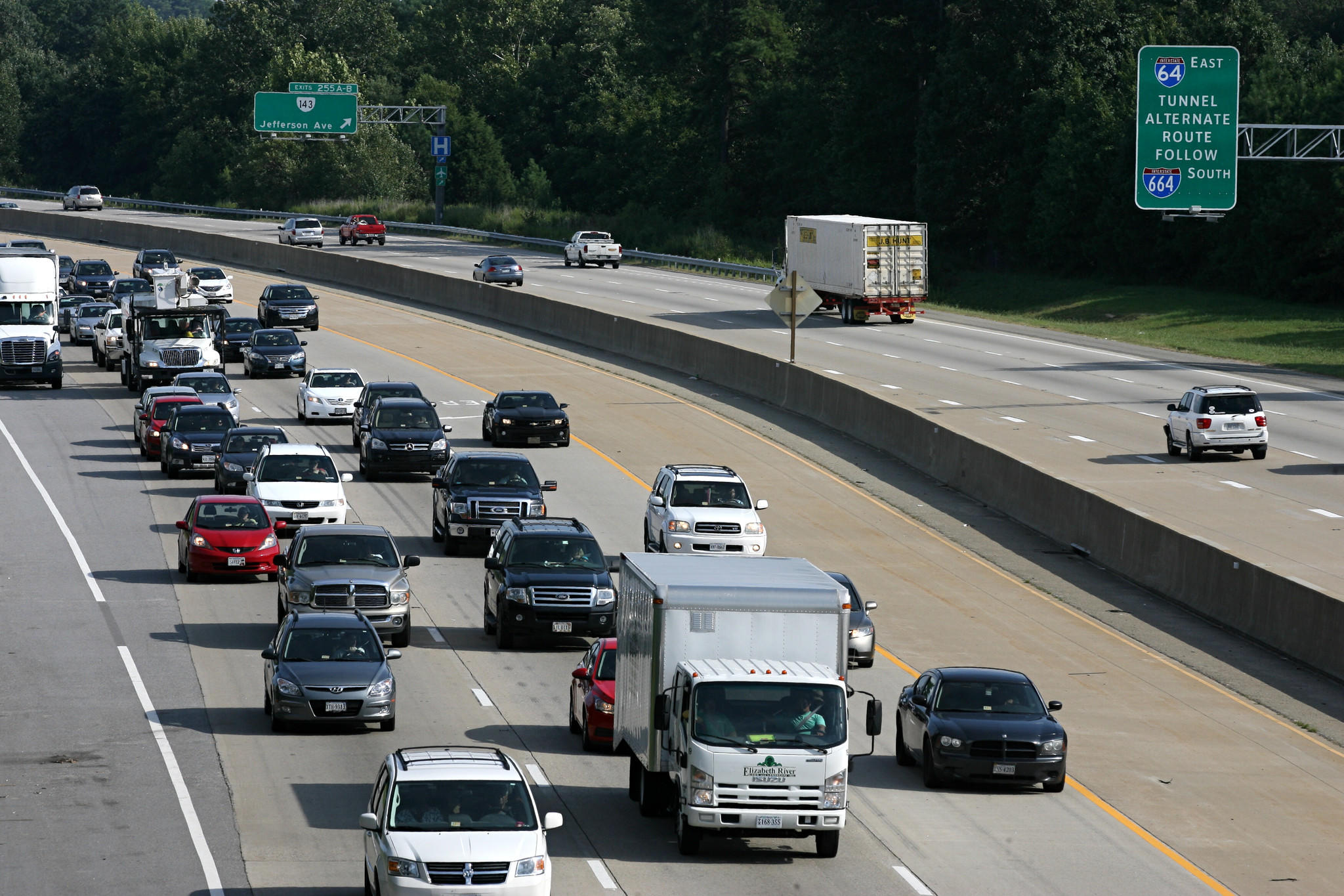 Traffic builds along Interstate 64 west near the Bland Boulevard overpass Thursday. Traffic for the Labor Day holiday weekend is expected to be heavy.
