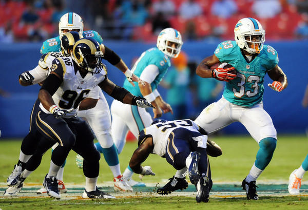 Daniel Thomas looks for some running room against the Rams
