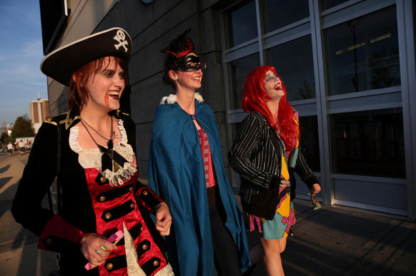 (L to R)Hannah Barnes, 17, Tricia Nagel, 17, and Maddie Moller, 16, arrive in costume for an Arcade Fire concert at the United Center.