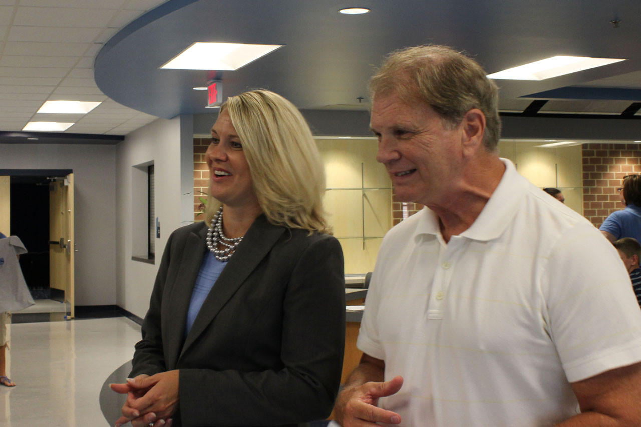 Georgie D. Tyler Middle School Principal Susan Goetz and Phil Jepson, the school system's director of human resources, welcome parents and students to the brand new school at Friday's open house.