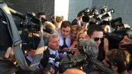 Former Gov. Bob McDonnell leaves the federal courthouse through a media scrum Friday, following closing arguments.