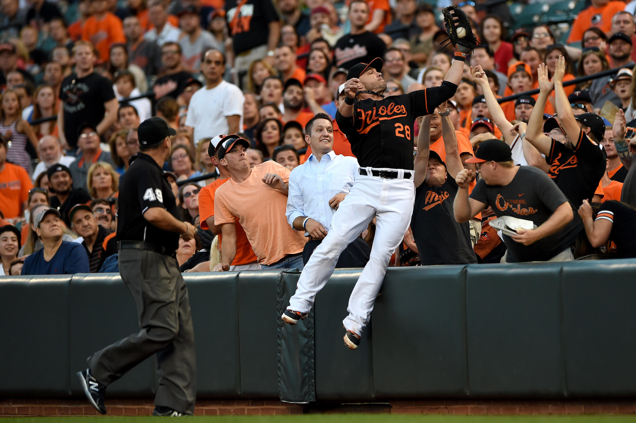 Steve Pearce makes a leaping catch in foul territory. He later left the game with an abdominal strain.