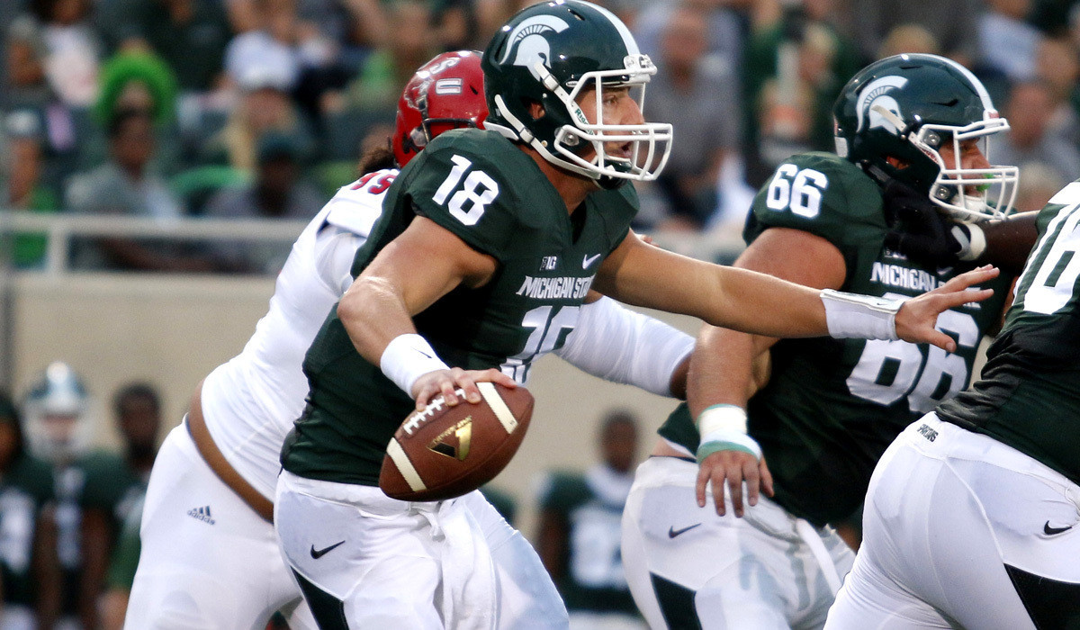 Michigan State gets win and scare from quarterback
