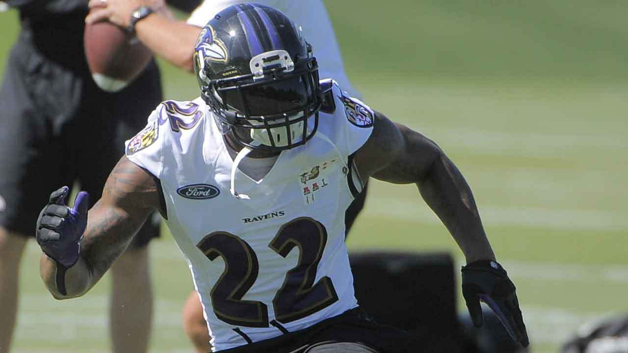 Jimmy Smith takes part in drills at the Ravens' training facility on July 25.
