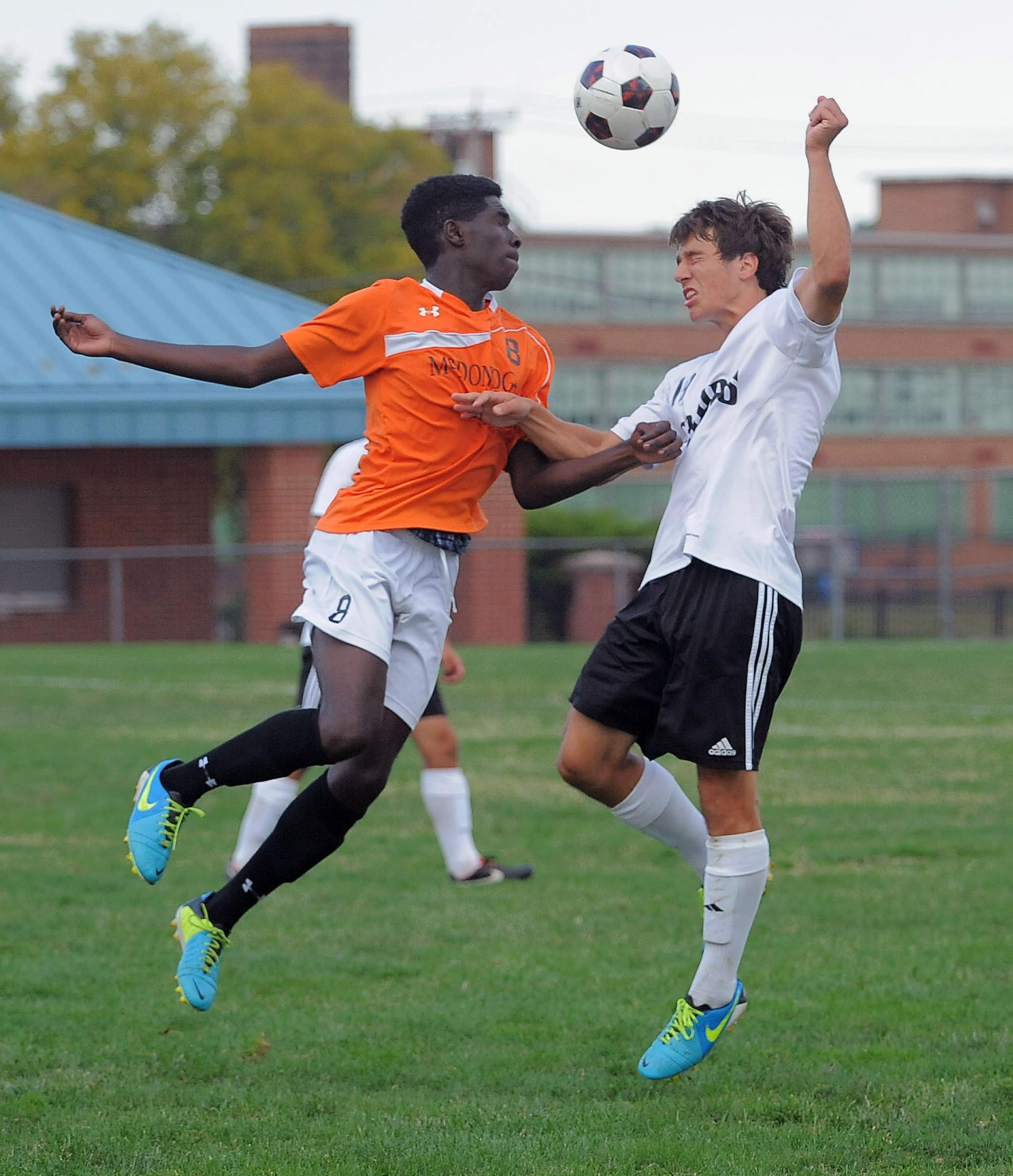 McDonogh Eagles forward Aquinas (Tunde) Akinlosotu and Archbishop Curley Friars back Tyler Ihle both leap to head the ball.