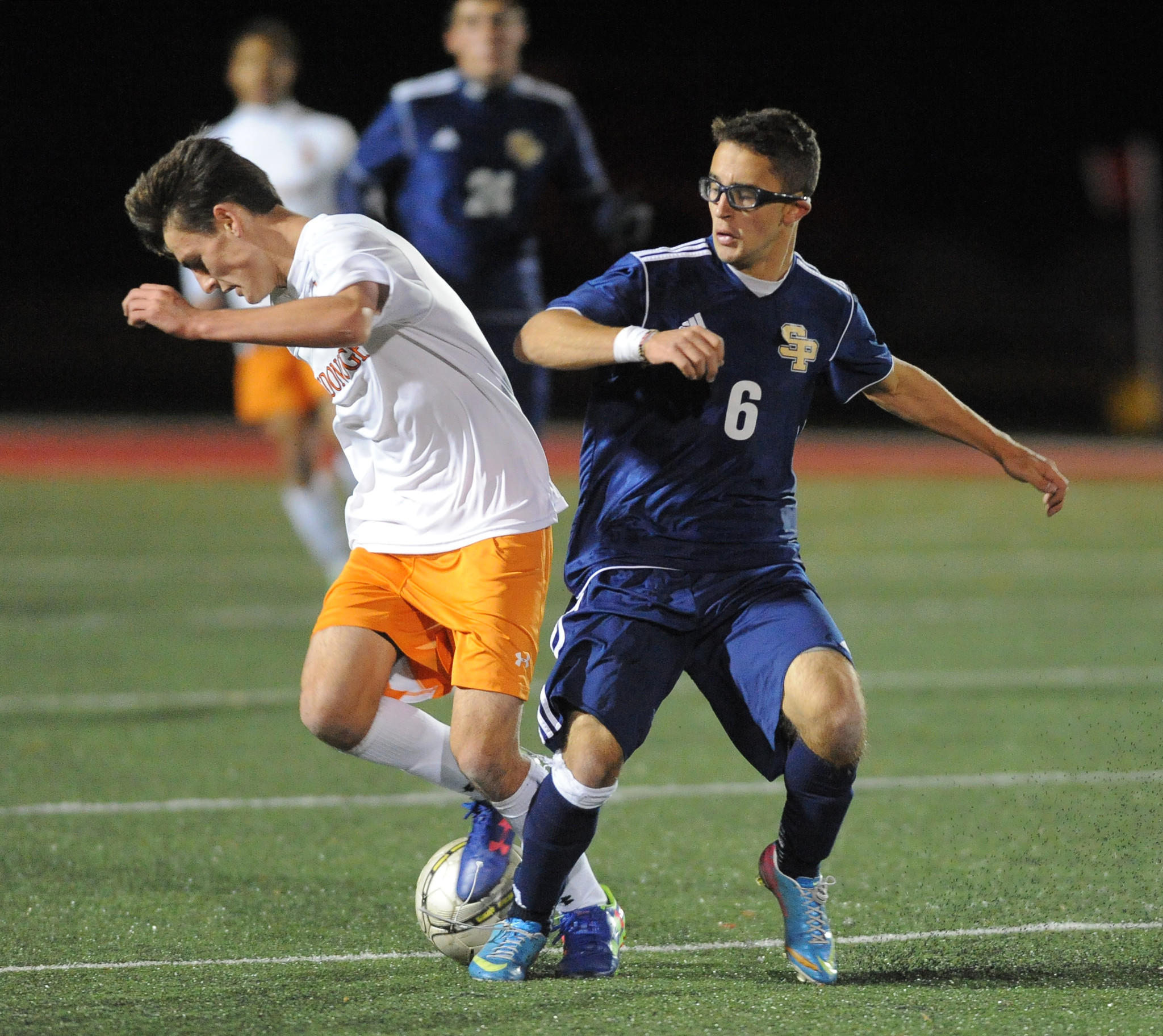 McDonogh's Keegan Kelly, left, and St. Paul's' Nate Hall try to get a foot to the ball.