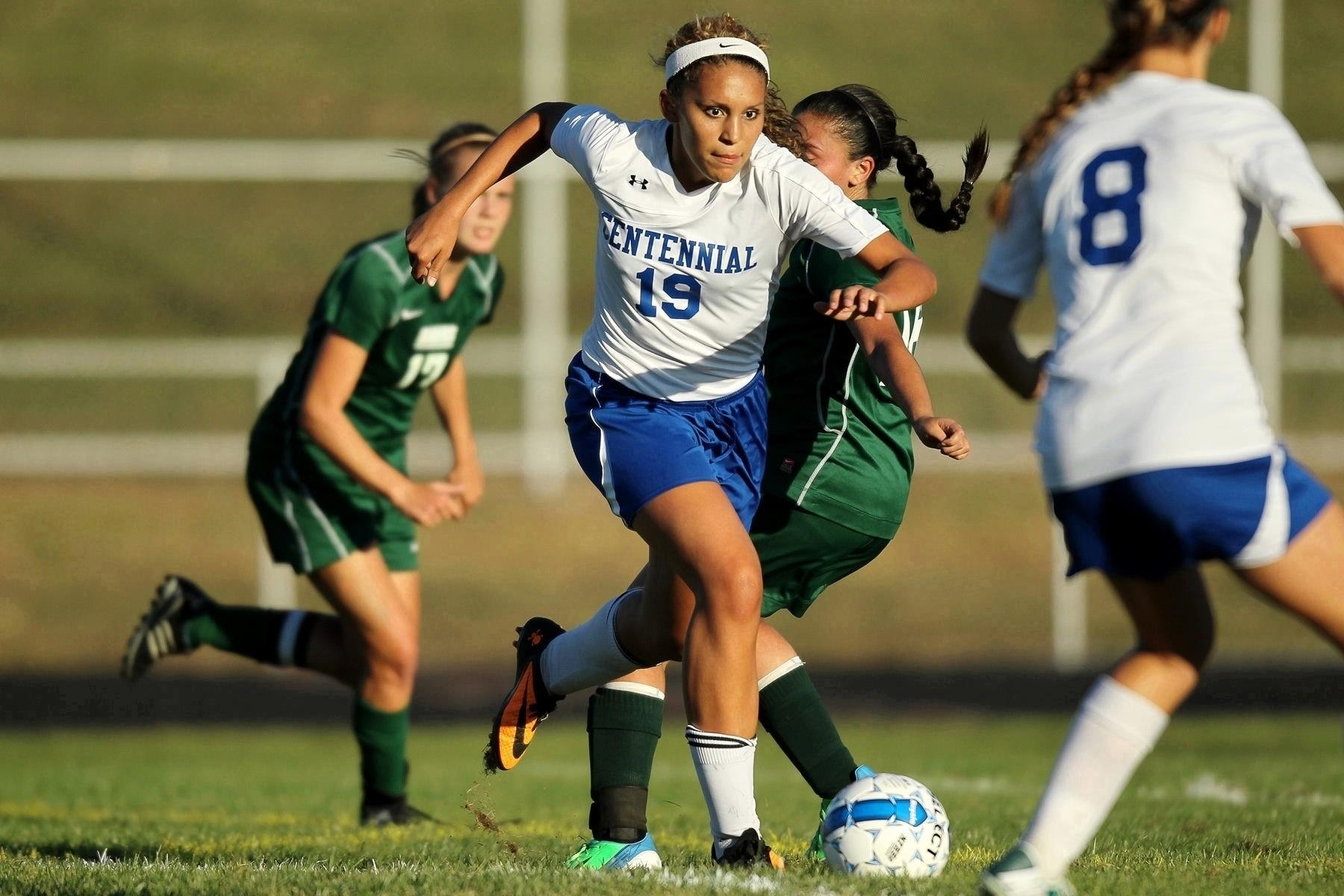 Centennial's Anna Mitchell dribbles the ball during the girls soccer game against Atholton.