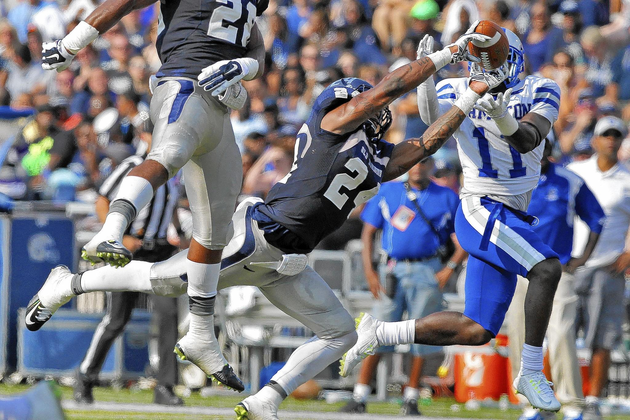 Old Dominion University's Fellonte Misher, center, intercepts a ball intended for Hampton University's Rayshad Riddick during Saturday's game at Foreman Field.