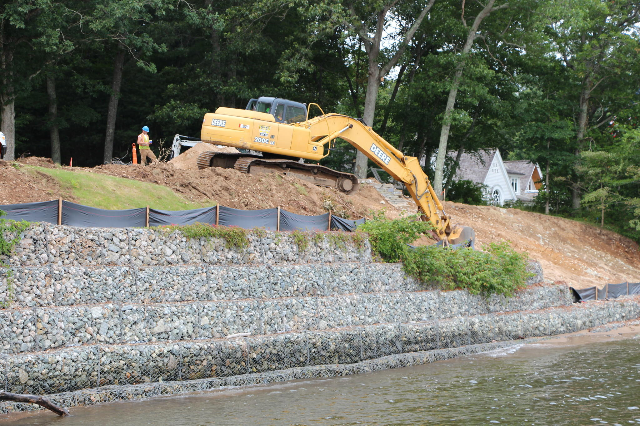 A decade ago, David and Betsy Sams built this retaining wall to protect their home, and their neighbor's home, from erosion they feared was threatening their home on the Connecticut River. But it is above the high tide line, it violates state and local regulations, and it now has to be torn down. It cost about $150,000 to build, it will cost about $300,000 to tear down, and the family also spent hundreds of thousands in court.