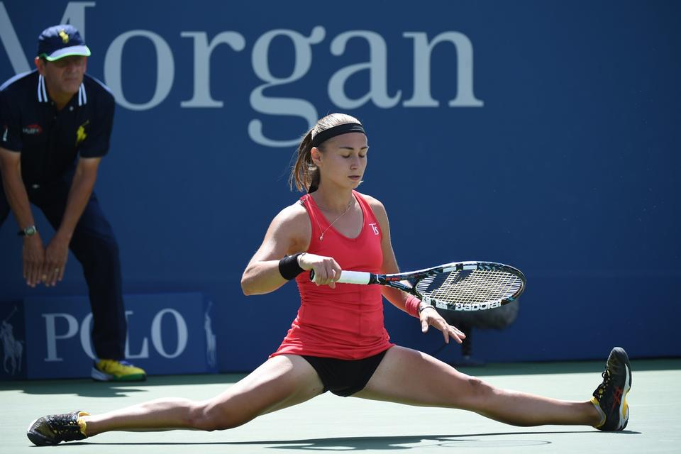 Aleksandra Krunic of Serbia plays against Petra Kvitova of the Czech Republic during their 2014 US Open women's singles match at the USTA Billie Jean King National Tennis Center on August 30, 2014 in New York. Krunic won 6-4 6-4.