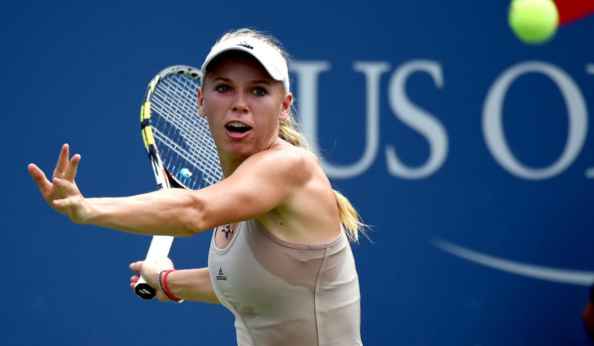 Caroline Wozniacki outlasts Maria Sharapova in humid U.S. Open match