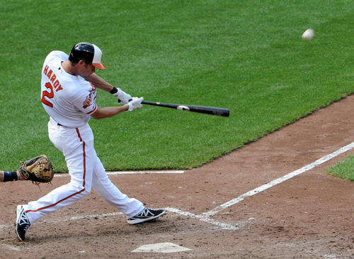 Orioles shortstop J.J. Hardy hits a grand slam in the sixth inning against the Minnesota Twins at Camden Yards.