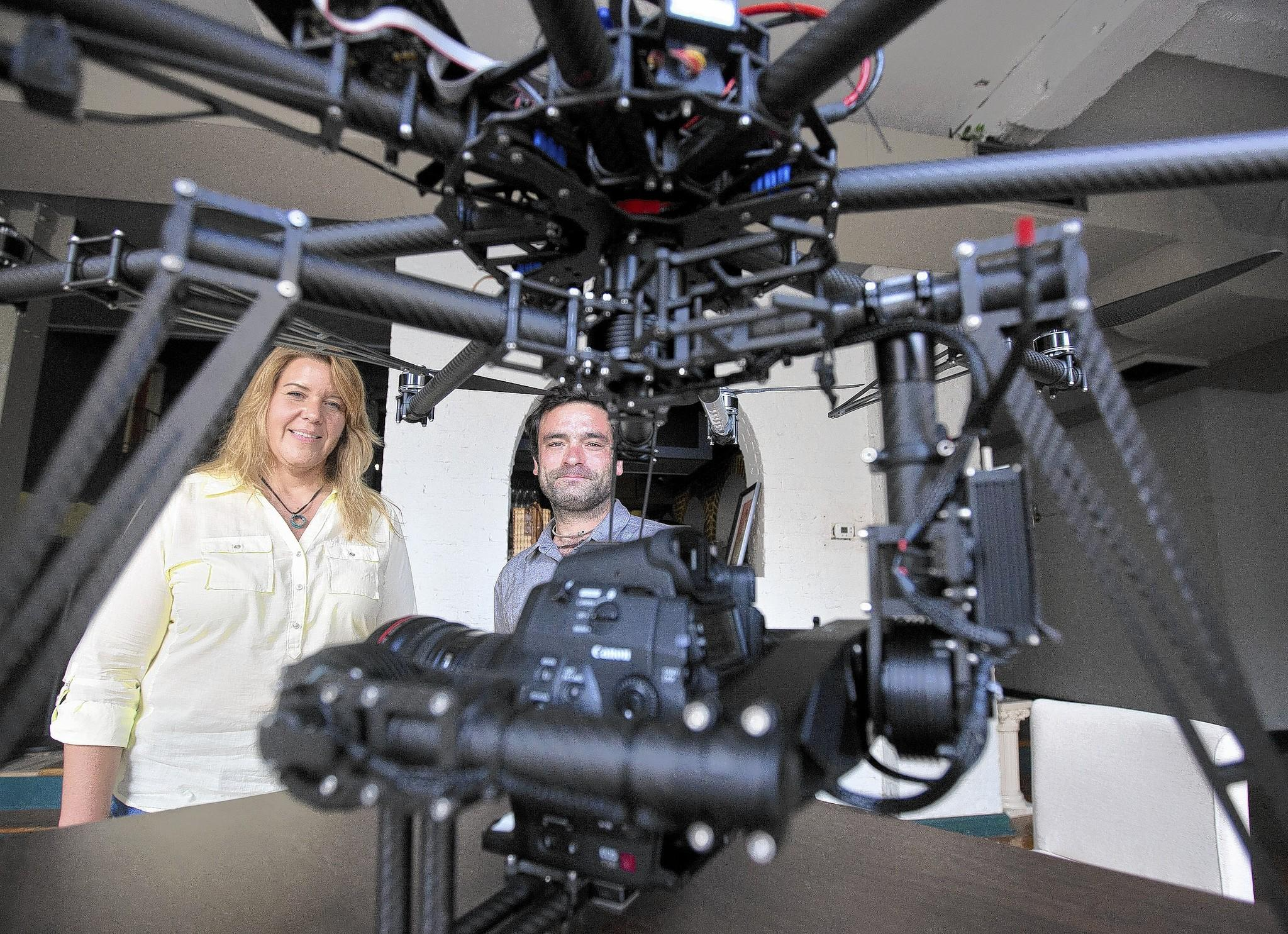 Kathy Martin and Jacin Buchanan of m2 Pictures stand with a remote-controlled octocopter drone that the studio plans to use to film cable TV shows.