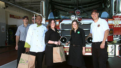 Watch: Olive Garden workers deliver food to firefighters