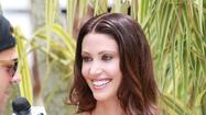 Shannon Elizabeth puts down her cards, picks up a mic