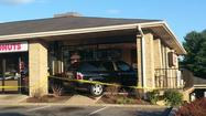 Car crashes into Dunkin Donuts in Ellicott City, seriously injuring two