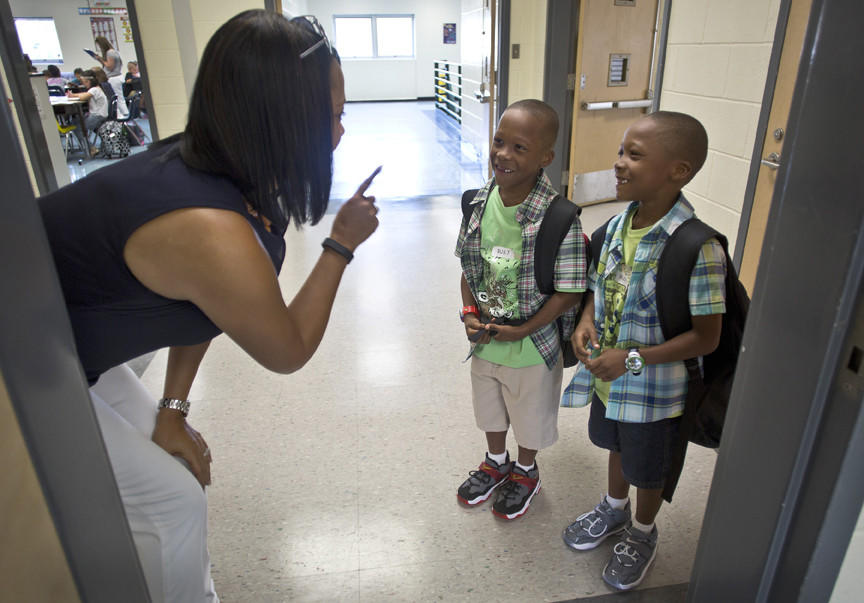The first day of school at Tina Hankins-Chelgren's third-grade class at Kiln Creek Elementary in Newport News. Hankins-Chelgren attempts to tell twins apart, Ty'quan and Arreon Cherry.