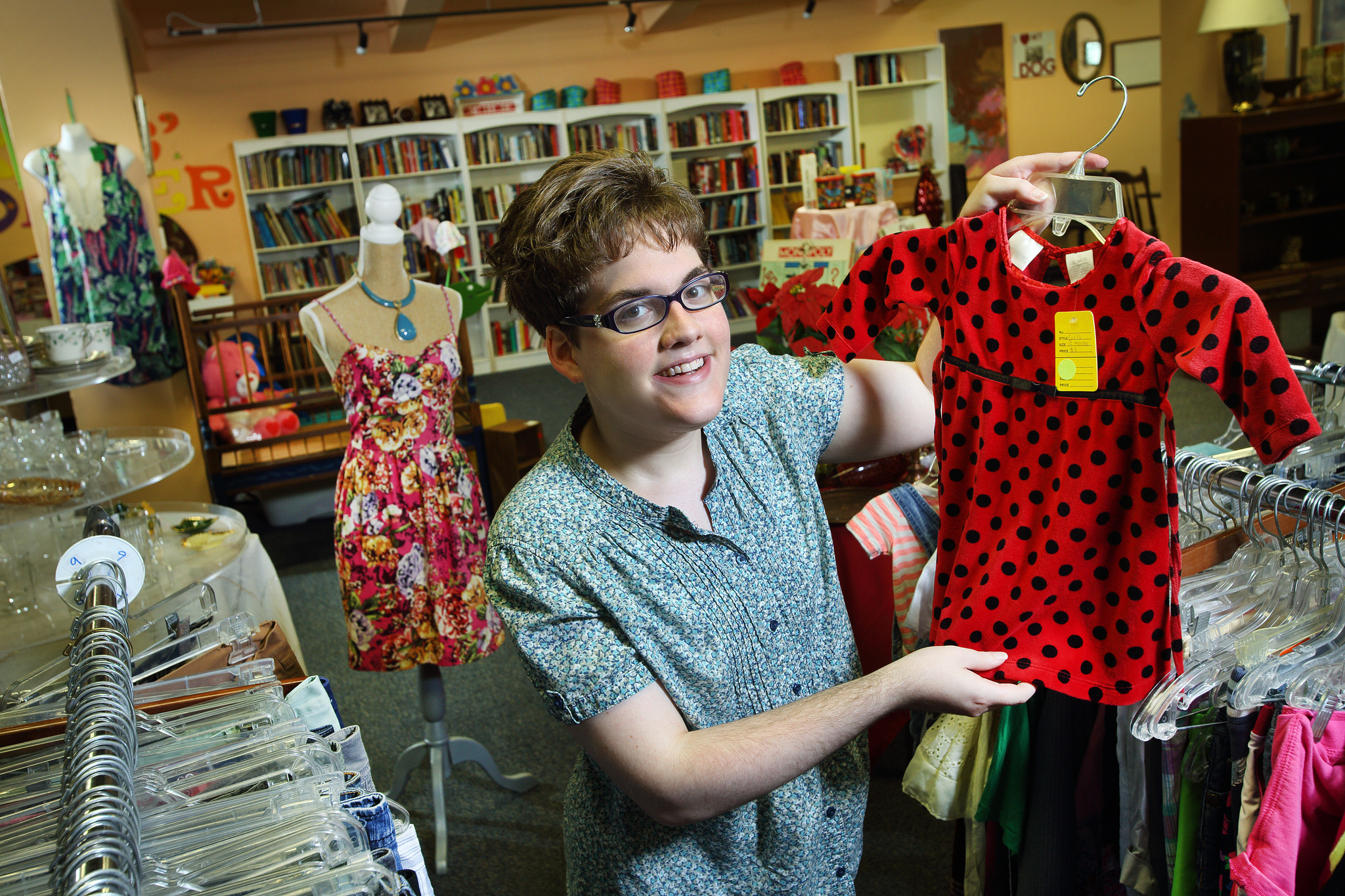 Ashleigh Wood has worked at Linwood Boutique, a thrift store that helps train autistic adults, for nearly four years.