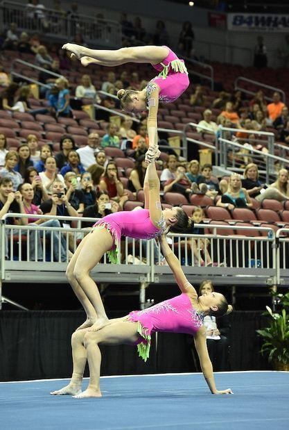 "Christina Antoniades, Emily Ruppert, Hannah Silverman are shown competing in the 2014 USA Gymnastics Championships in Louisville, Ky., in July. The three are part of the group, AcroArmy, appearing on ""America's Got Talent."""